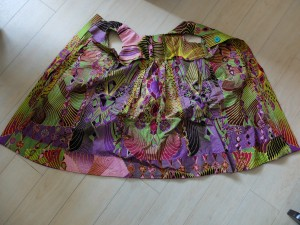 Take one dress and reach up inside the shoulders, putting one inside the other. Note the inner facings, top and bottom..